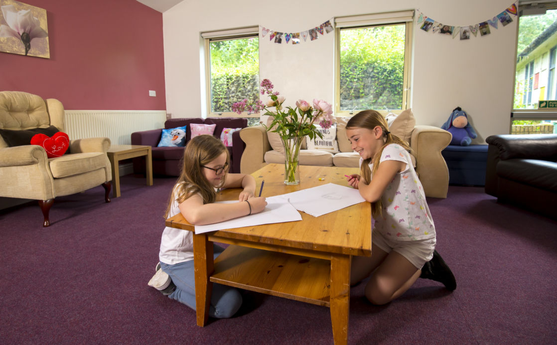 2 prep school girls studying in common room