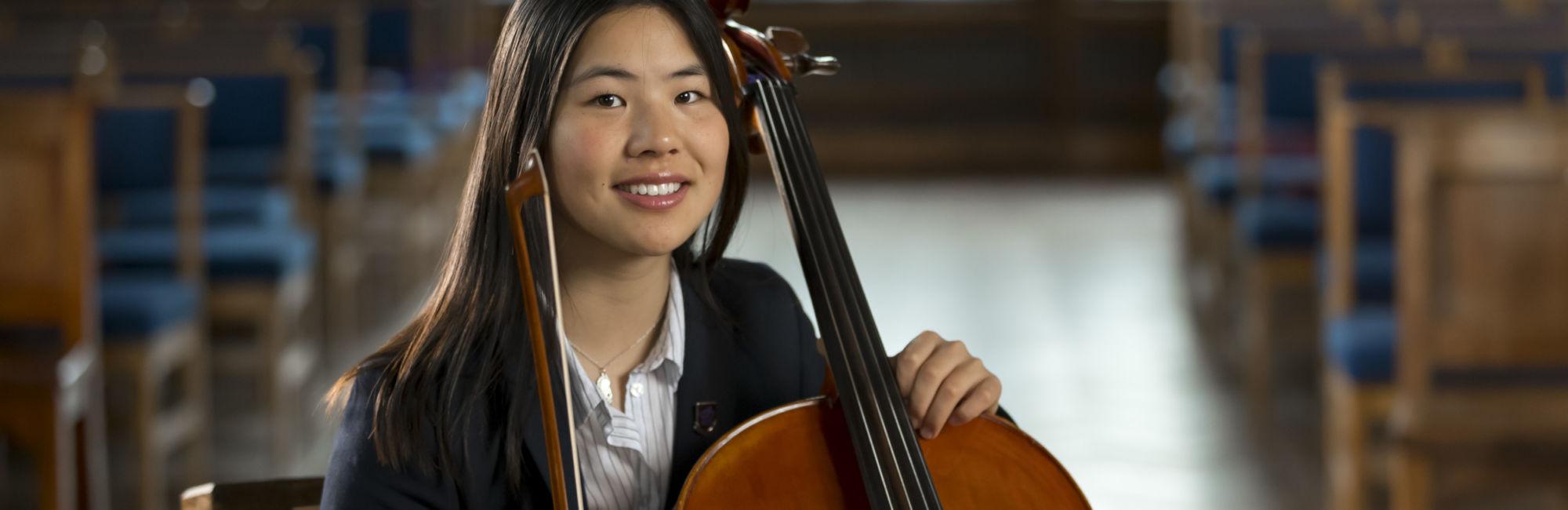 wycliffe girl holding a cello