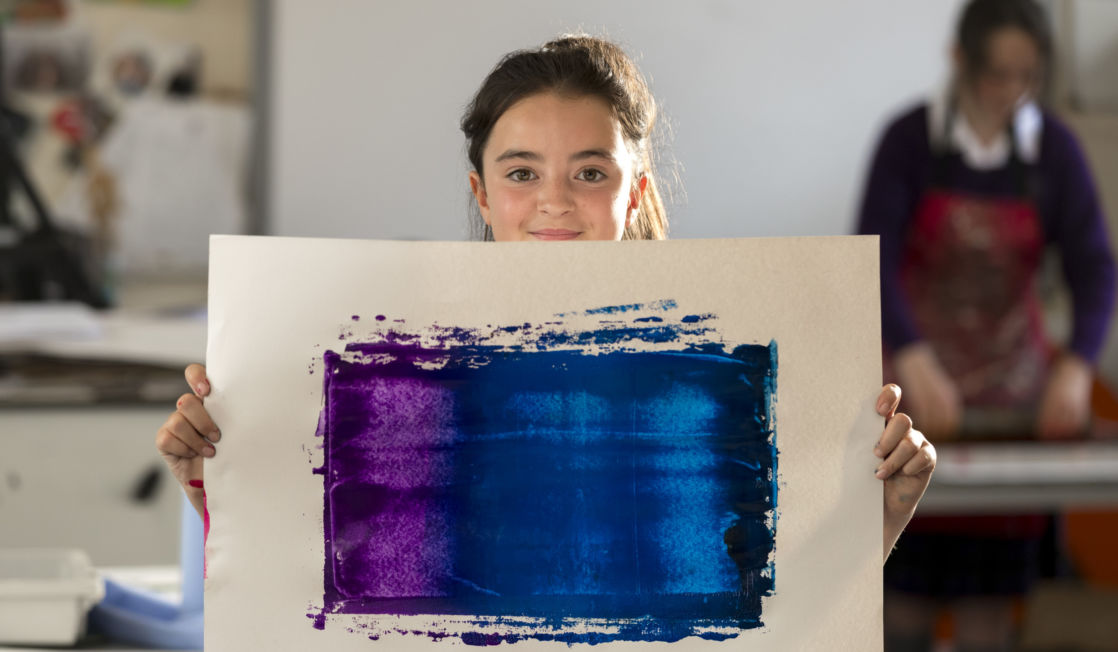 wycliffe pupil holding a painting