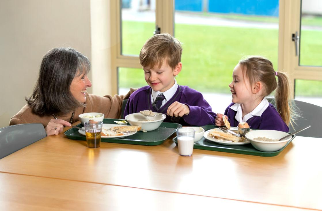 wycliffe teacher and students having breakfast