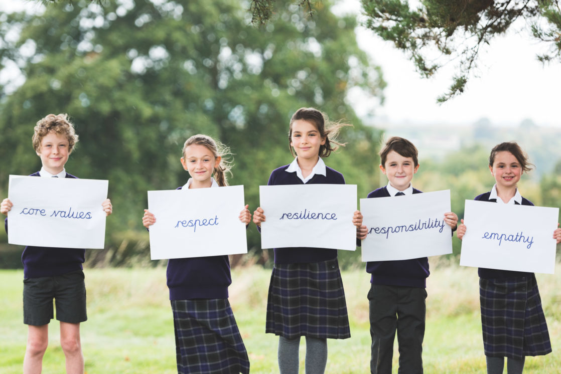 wycliffe pupils holding signs with values written