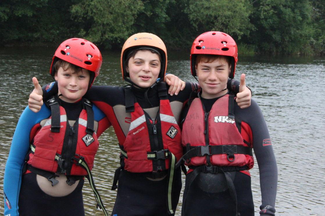 children at wycliffe independent school enjoying outdoor water sports