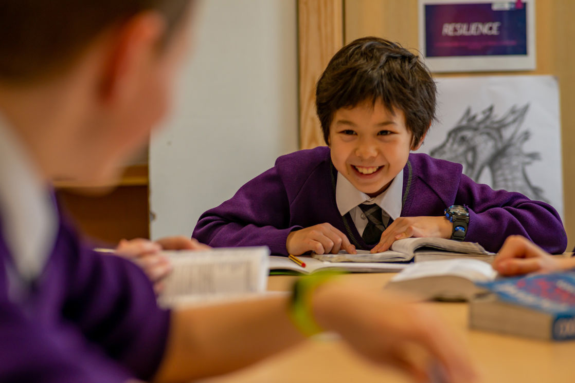 wycliffe boy smiling in class