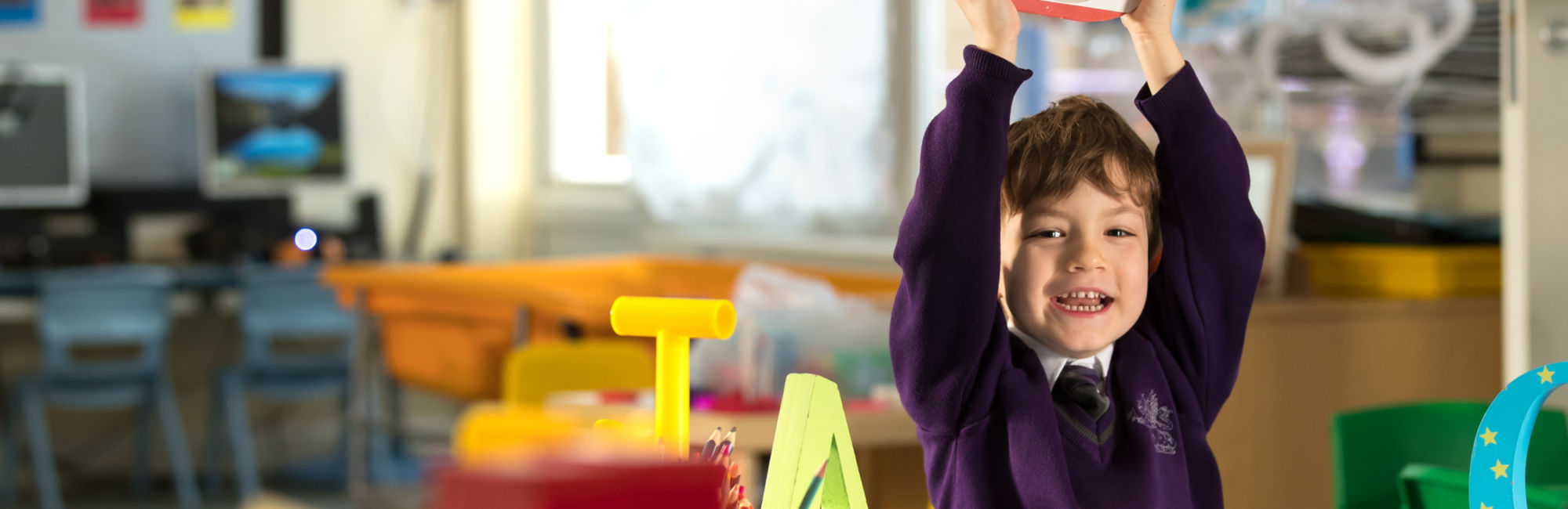 wycliffe ursery pupil playing with wooden letters