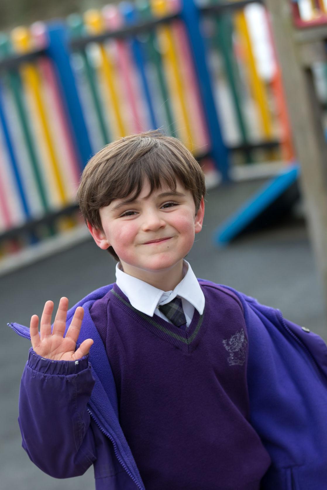 wycliffe nursery boy smiling in the playground