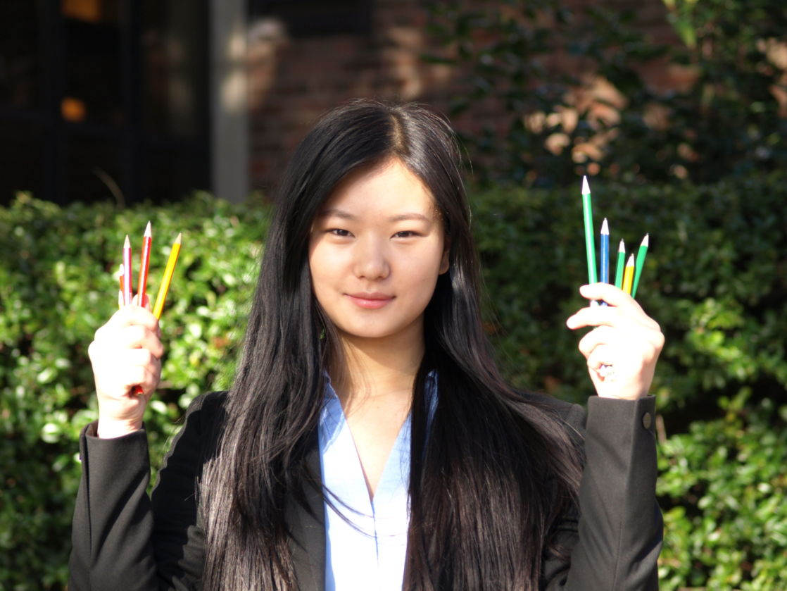 wycliffe pupil sophia holding colored pencils