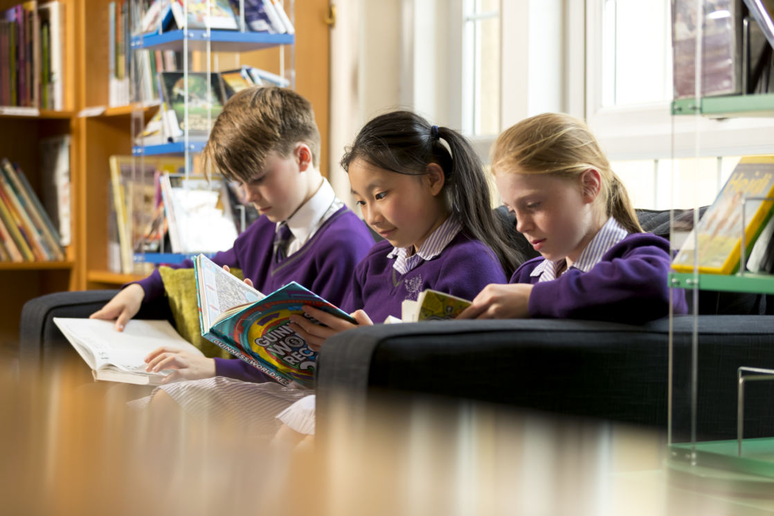 wycliffe kids reading in the library