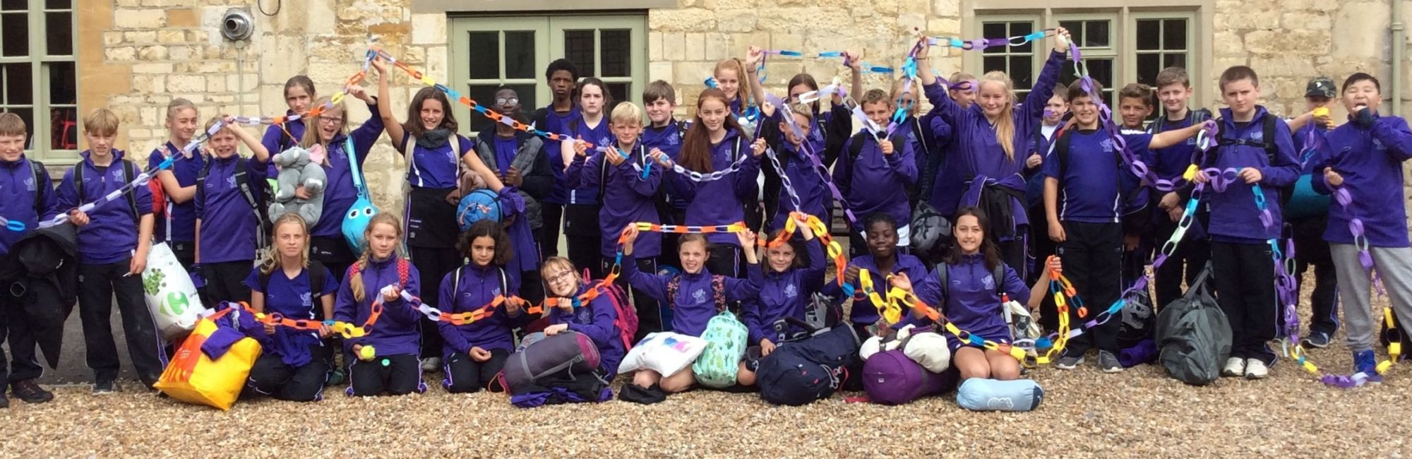wycliffe pupils holding decorations outdoors