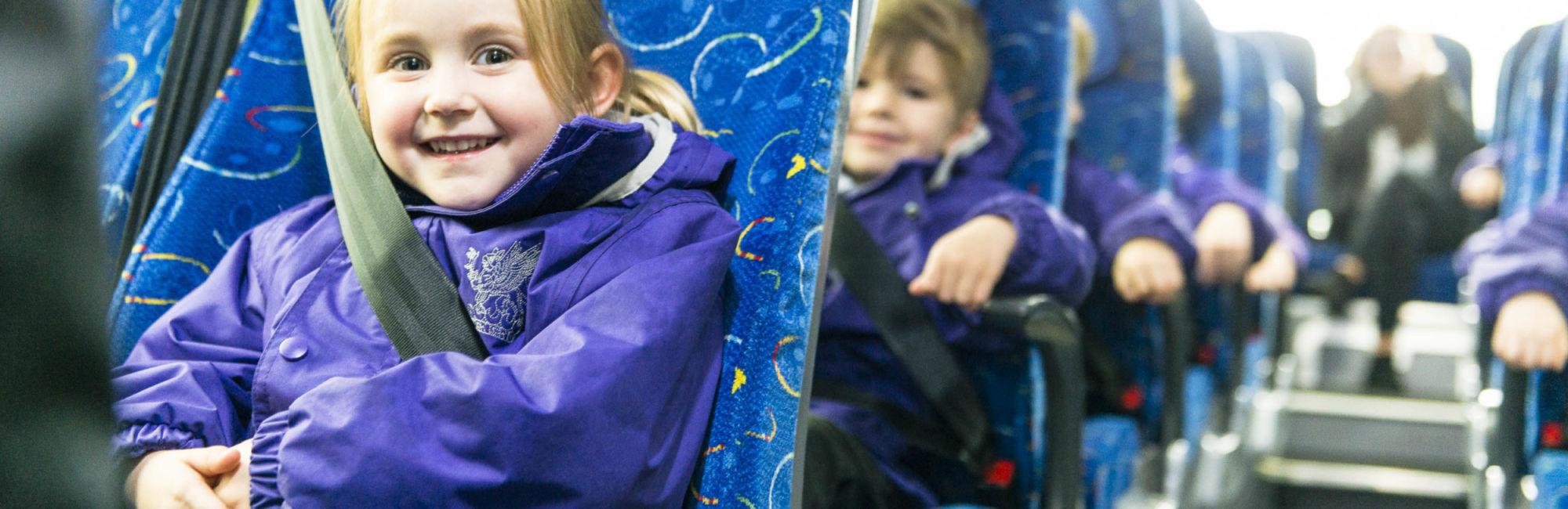 wycliffe nursery kids riding a minibus
