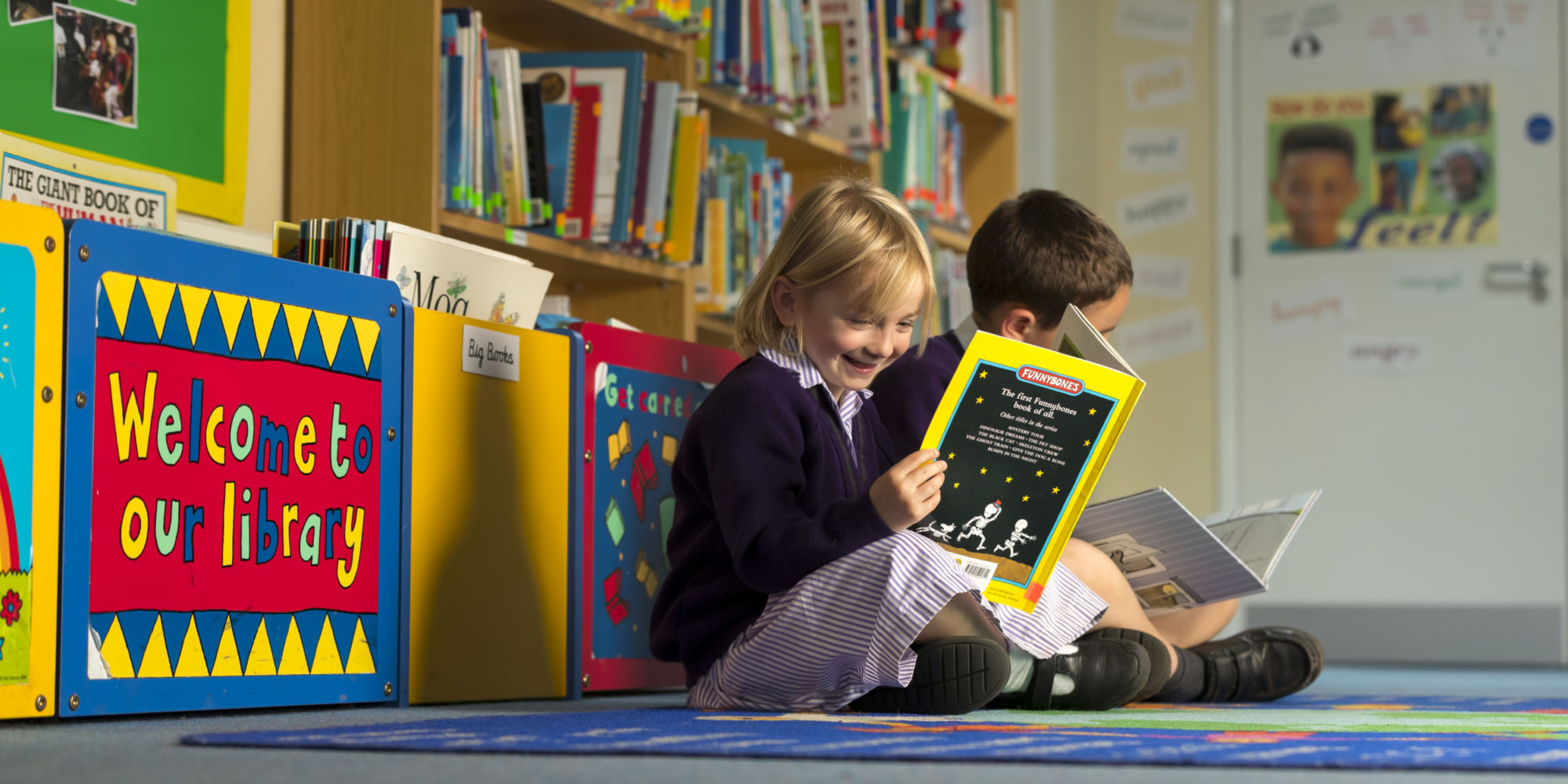 wycliffe nursery kids reading in the library