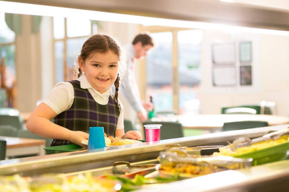 wycliffe pre prep student ording food in the cafeteria