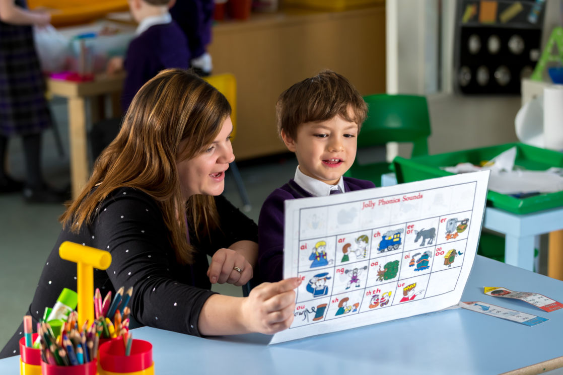 wycliffe teacher and student reading a phonics chart