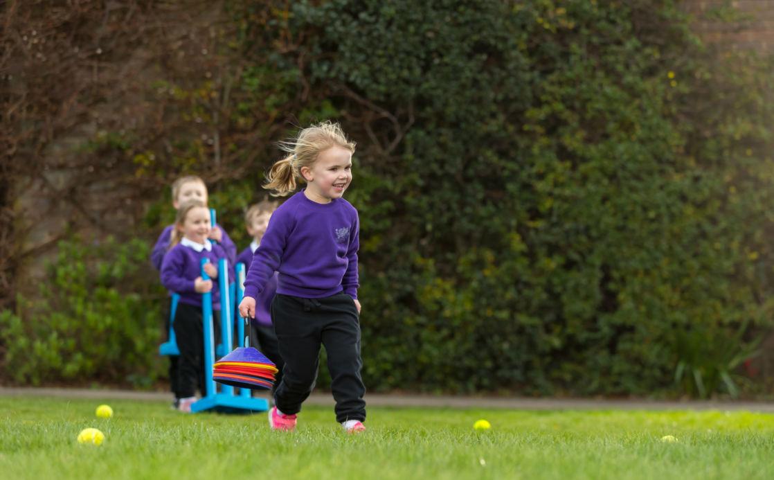 wycliffe nursery girl running in the playground