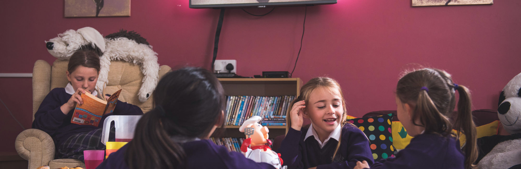 wycliffe girls reading and playing in their common lounge