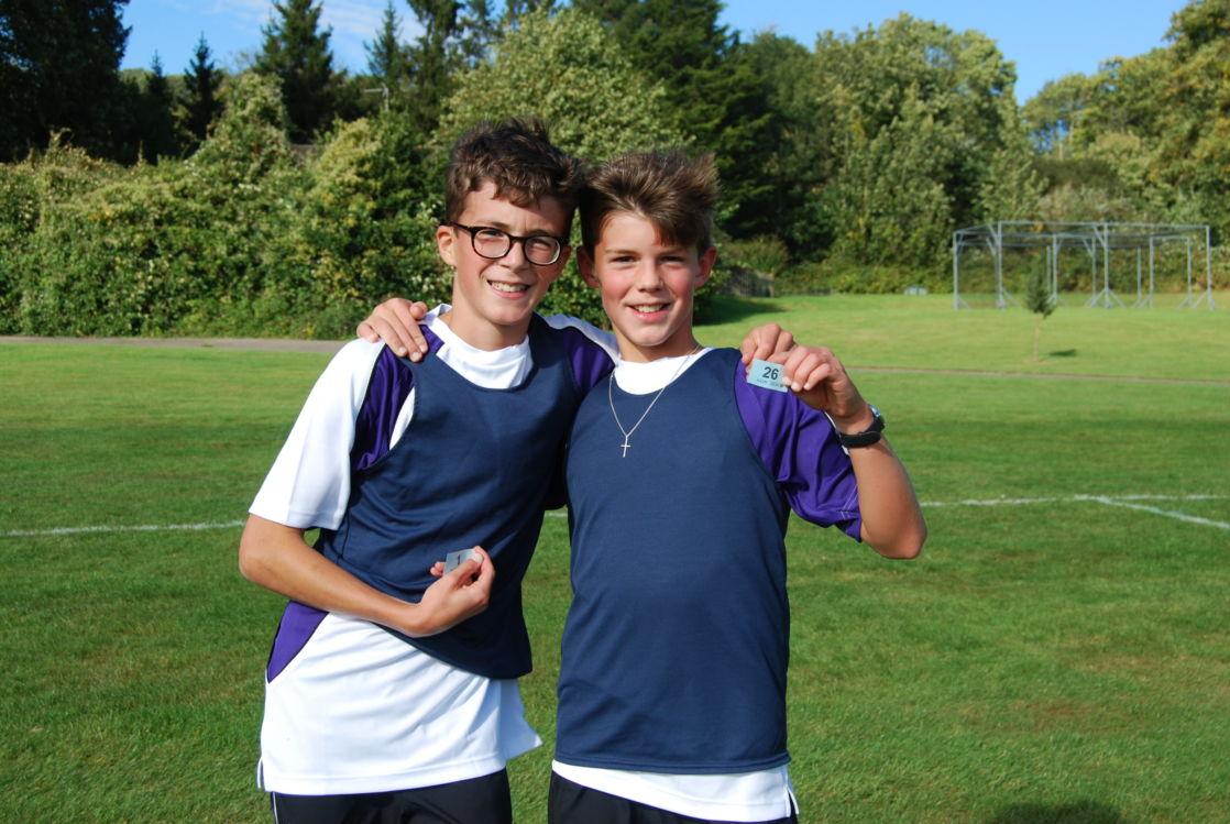 wycliffe boys smiling in a football field