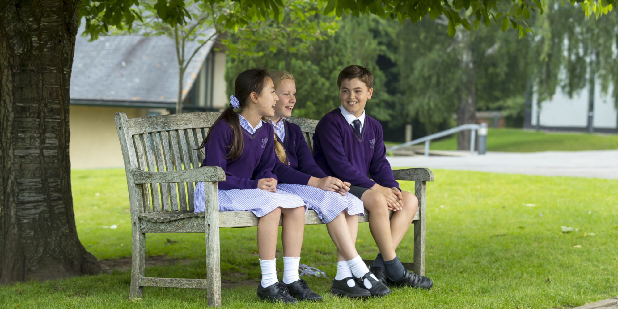 wycliffe pupils sitting on a bench outdoors