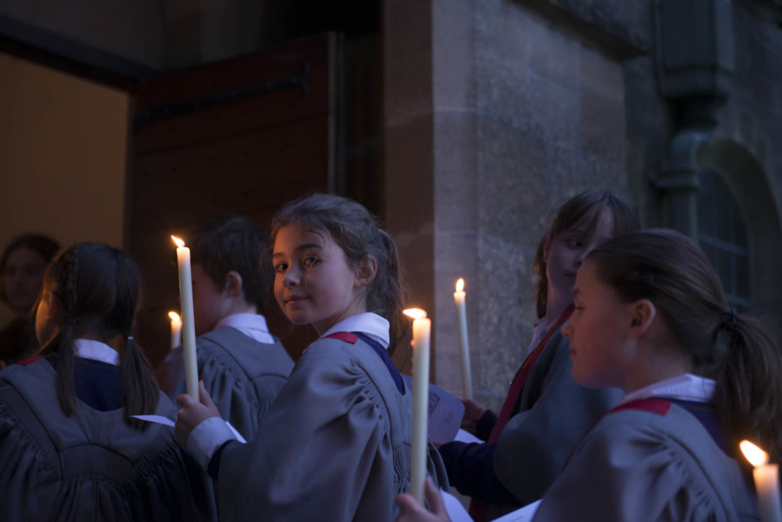 wycliffe pupils walking into a chapel holding candles