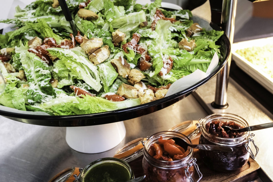 plate of salad and dressings