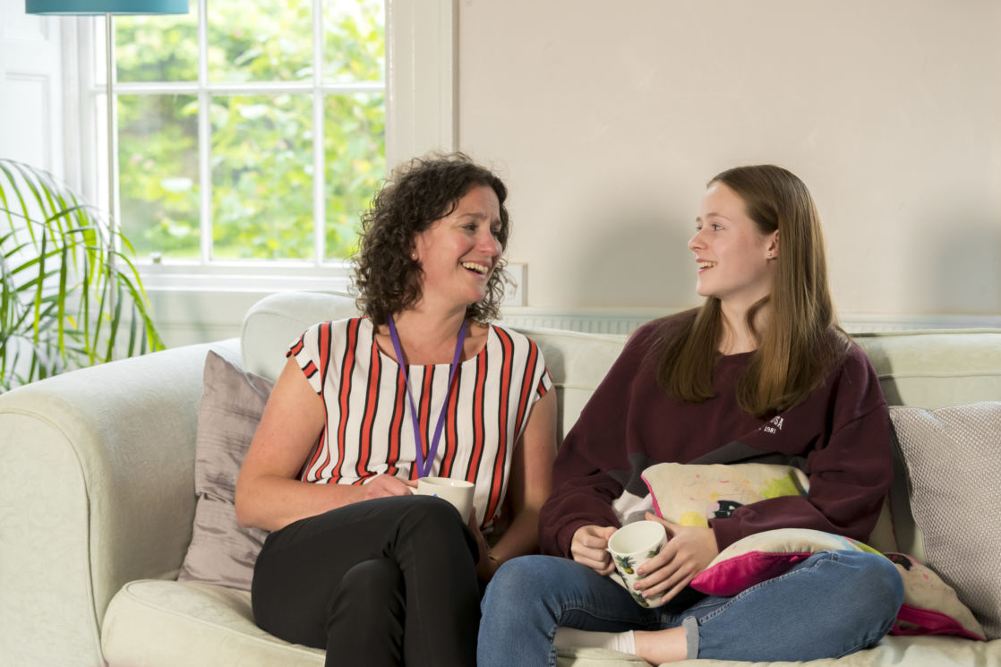 wycliffe pupil and teacher sitting on a couch