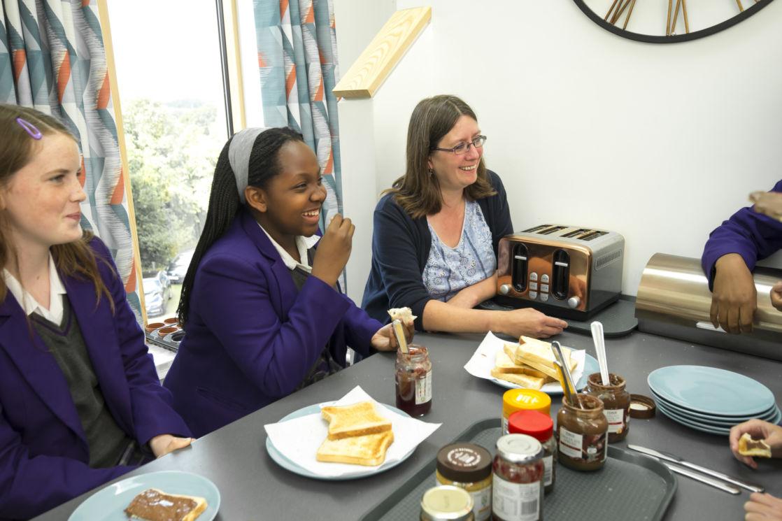 wycliffe girls and teacher having breakfast
