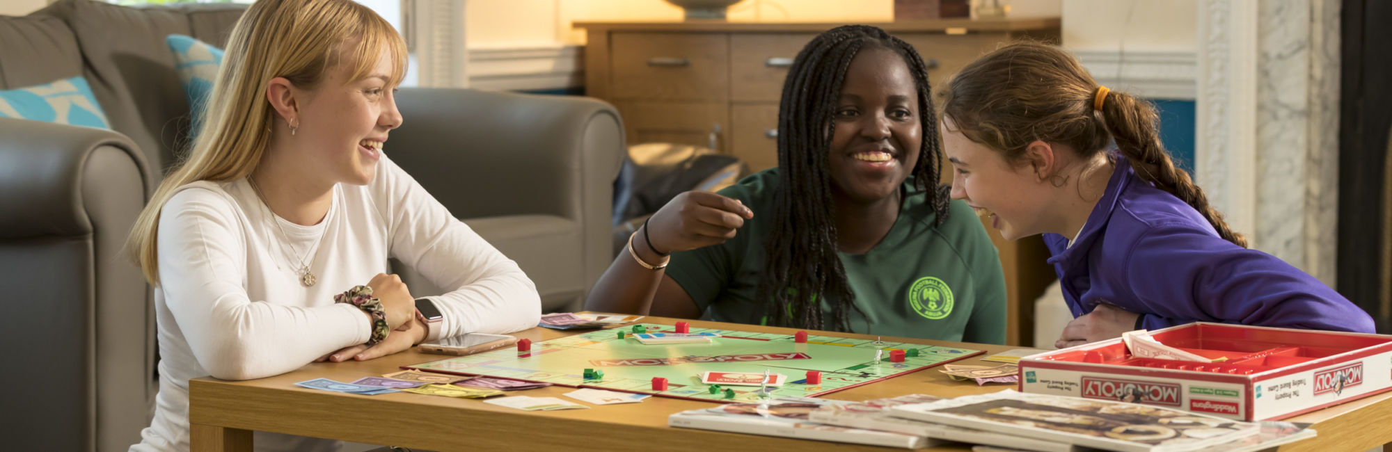 wycliffe girls playing monopoly in haywardsend house