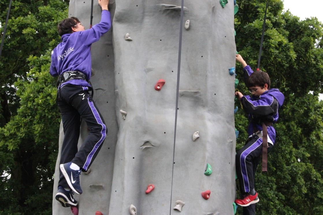 wycliffe pupils climbing a rock wall