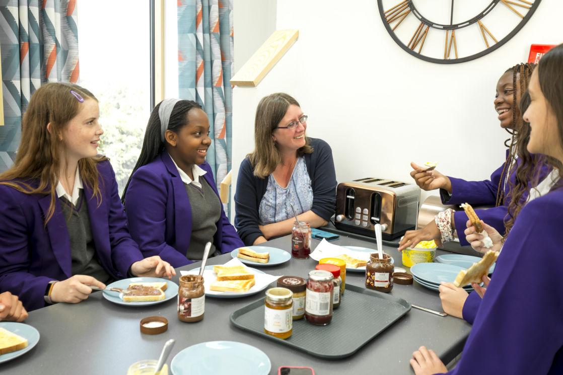 wycliffe flexi-boarding girls and teacher having breakfast