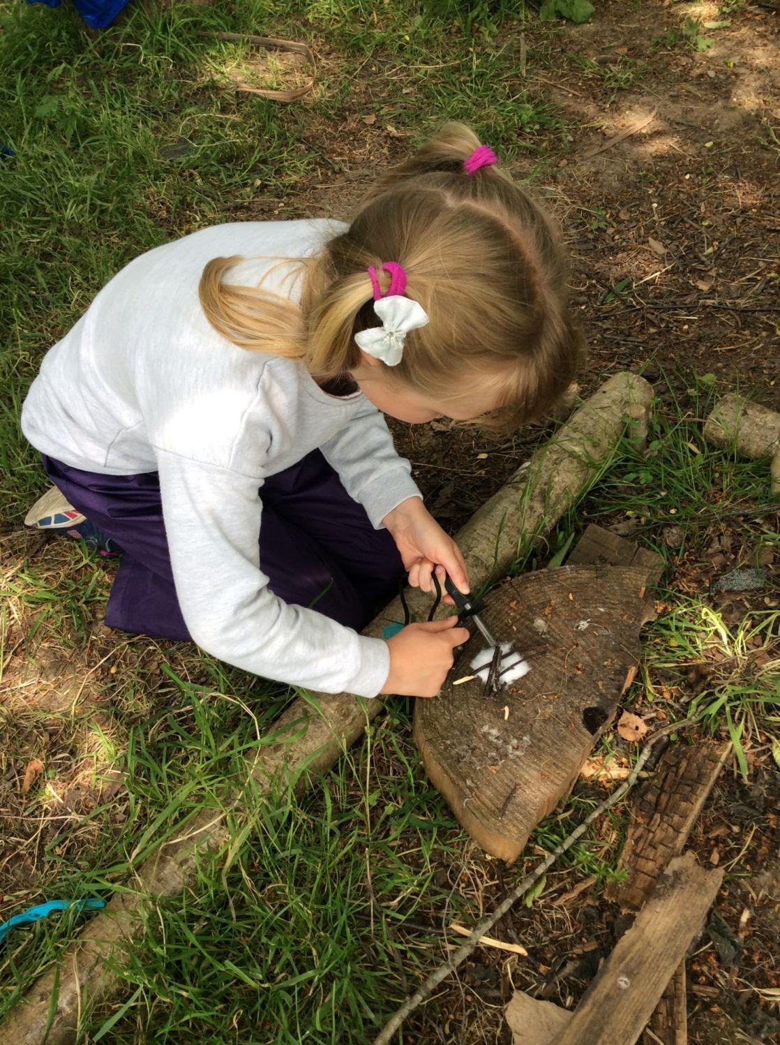 wycliffe girl making a fire in forest school