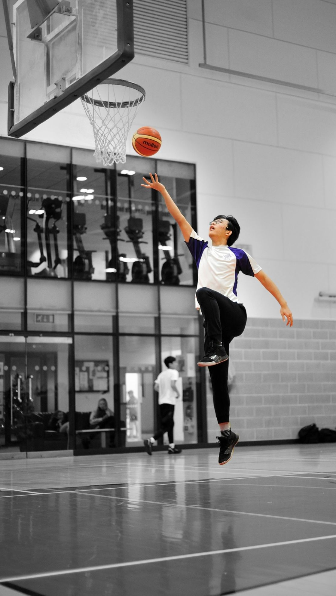 highlighted image of wycliffe pupil playing basketball
