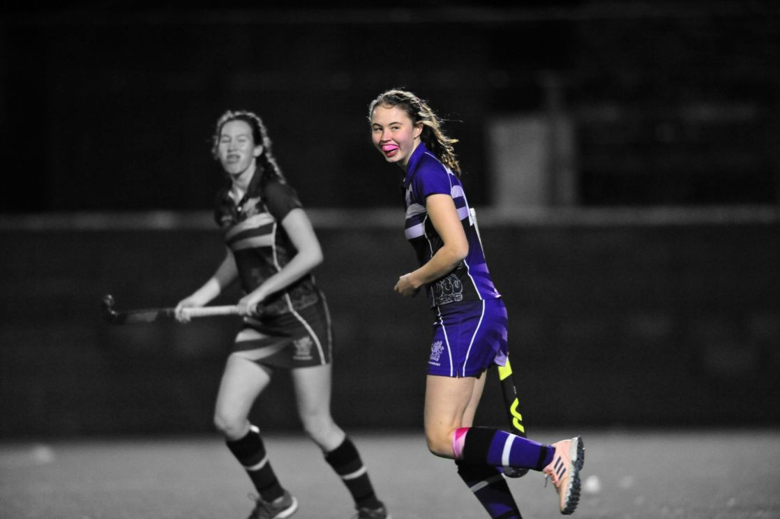 highlighted image of wycliffe girl playing hockey