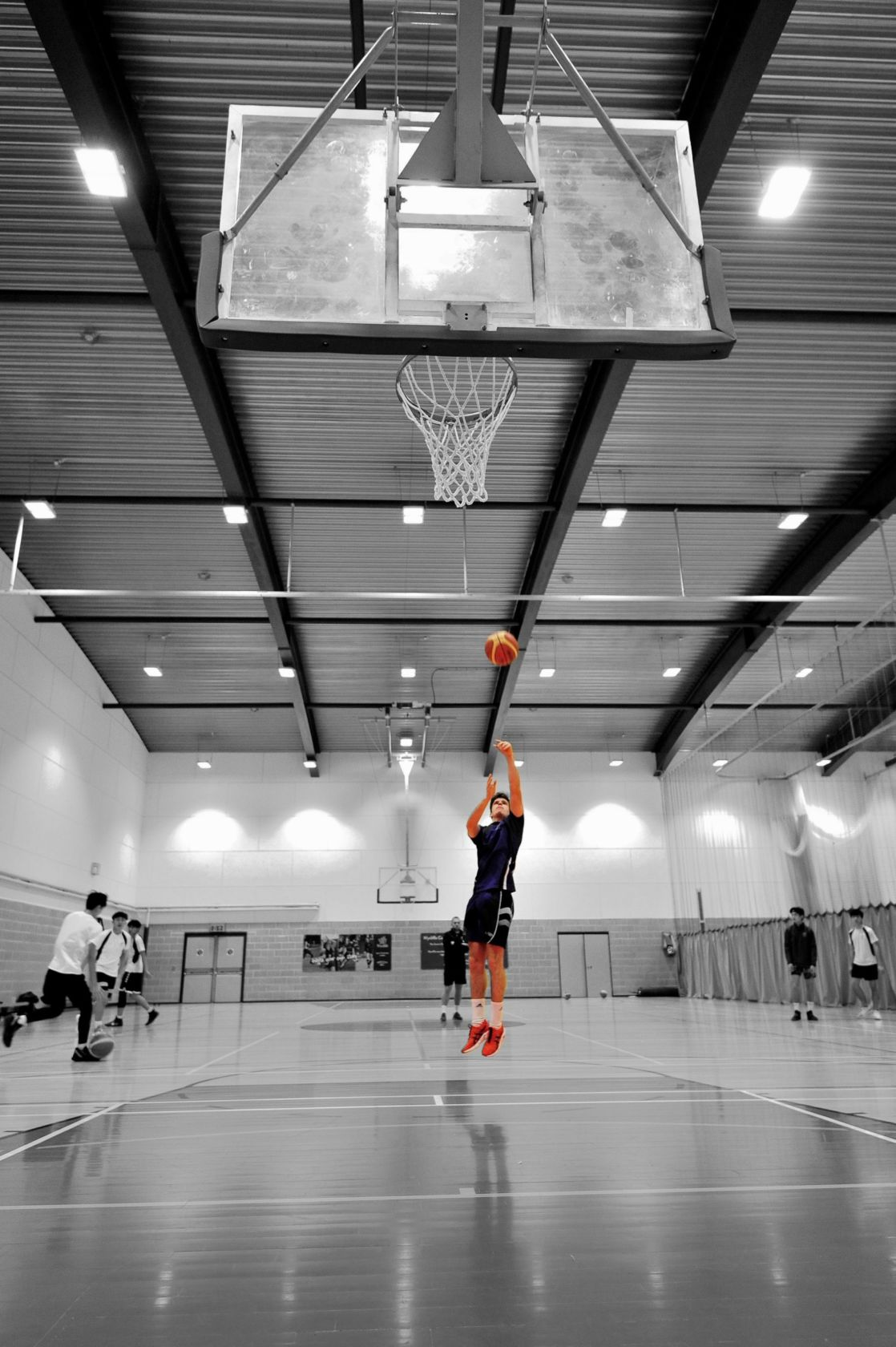 highlighted image of wycliffe boy playing basketball