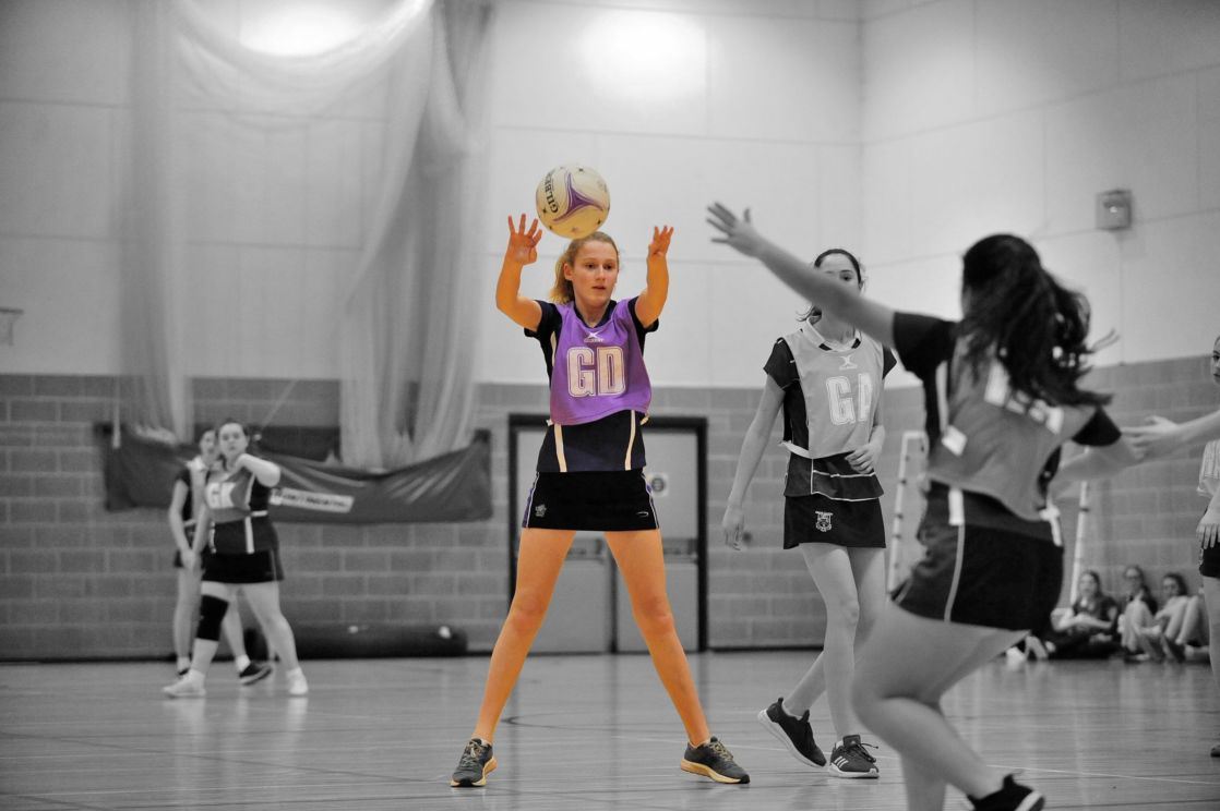 highlighted image of wycliffe girl playing netball