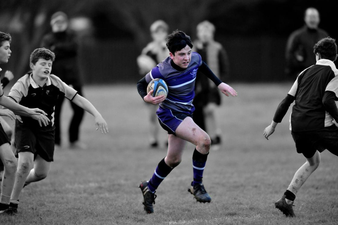 highlighted image of wycliffe boy playing rugby