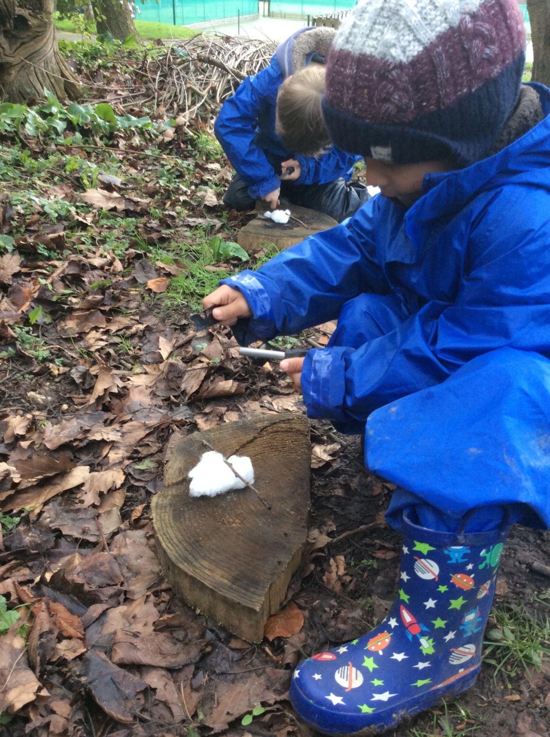 wycliffe kid making a fire in forest school