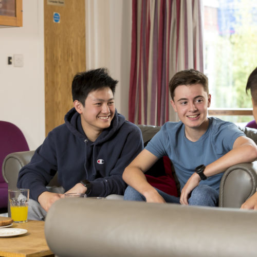 wycliffe boarding students sitting in the lounge room