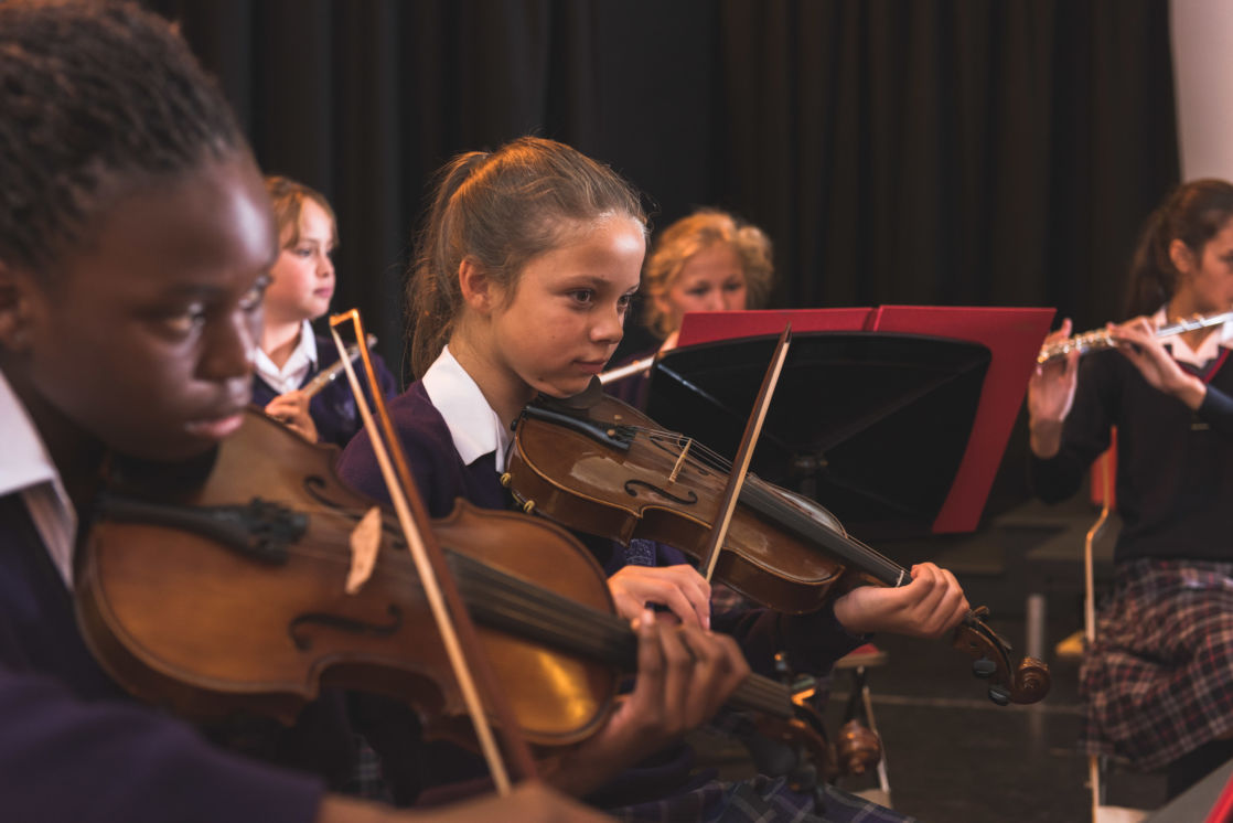 wycliffe pupils playing chord instruments