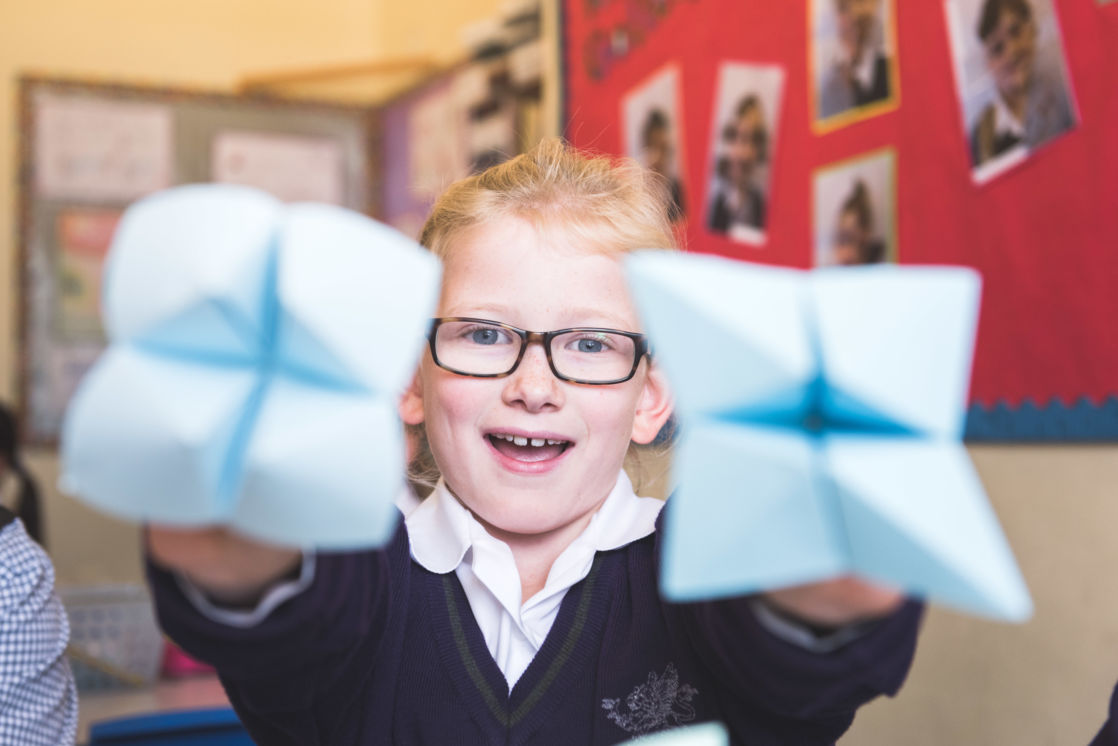 wycliffe pupil holding origami pieces