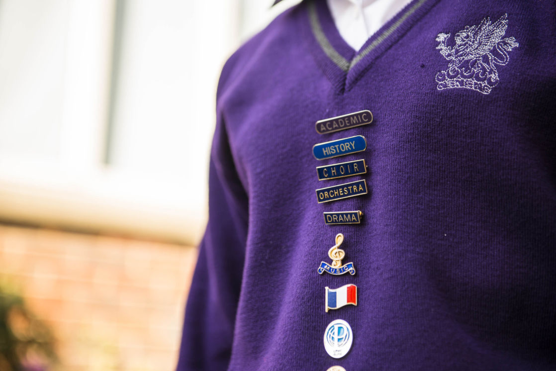 wycliffe student wearing badges