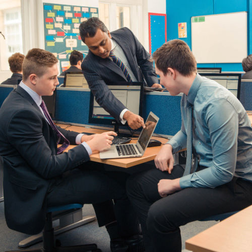 wycliffe seniors and teacher in the computer lab