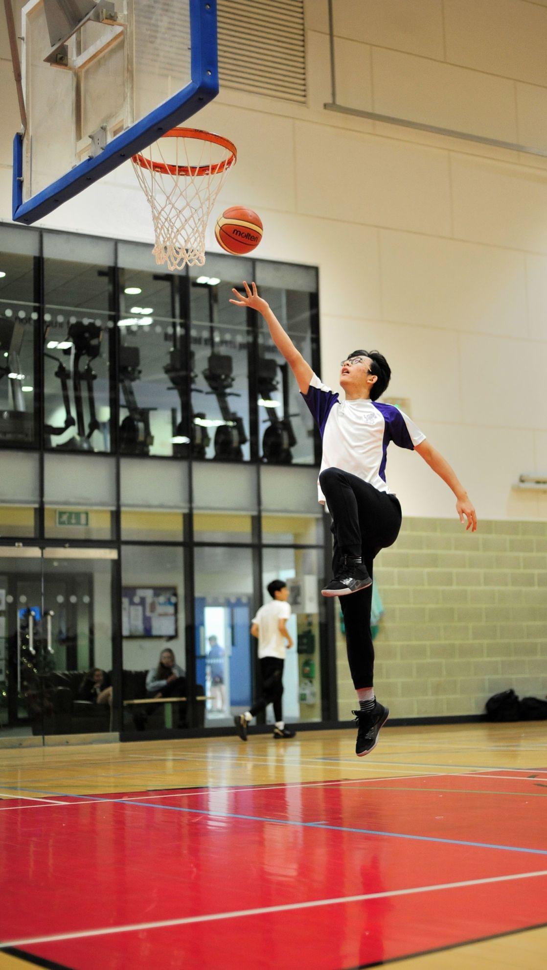 wycliffe pupil playing basketball