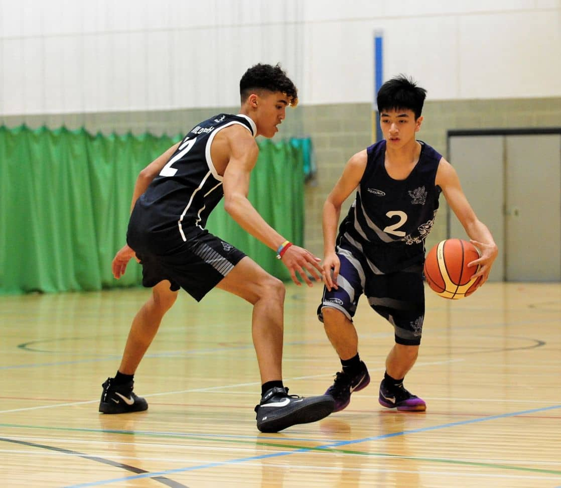 a pair of wycliffe students playing basketball