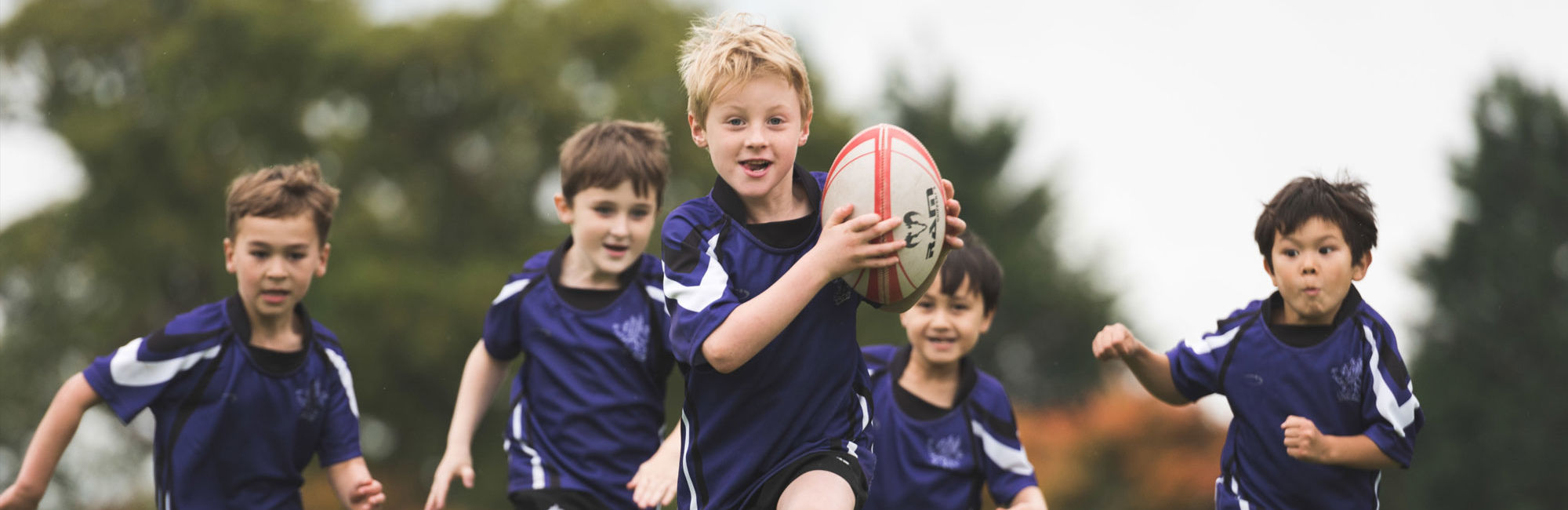 wycliffe kids playing rugby
