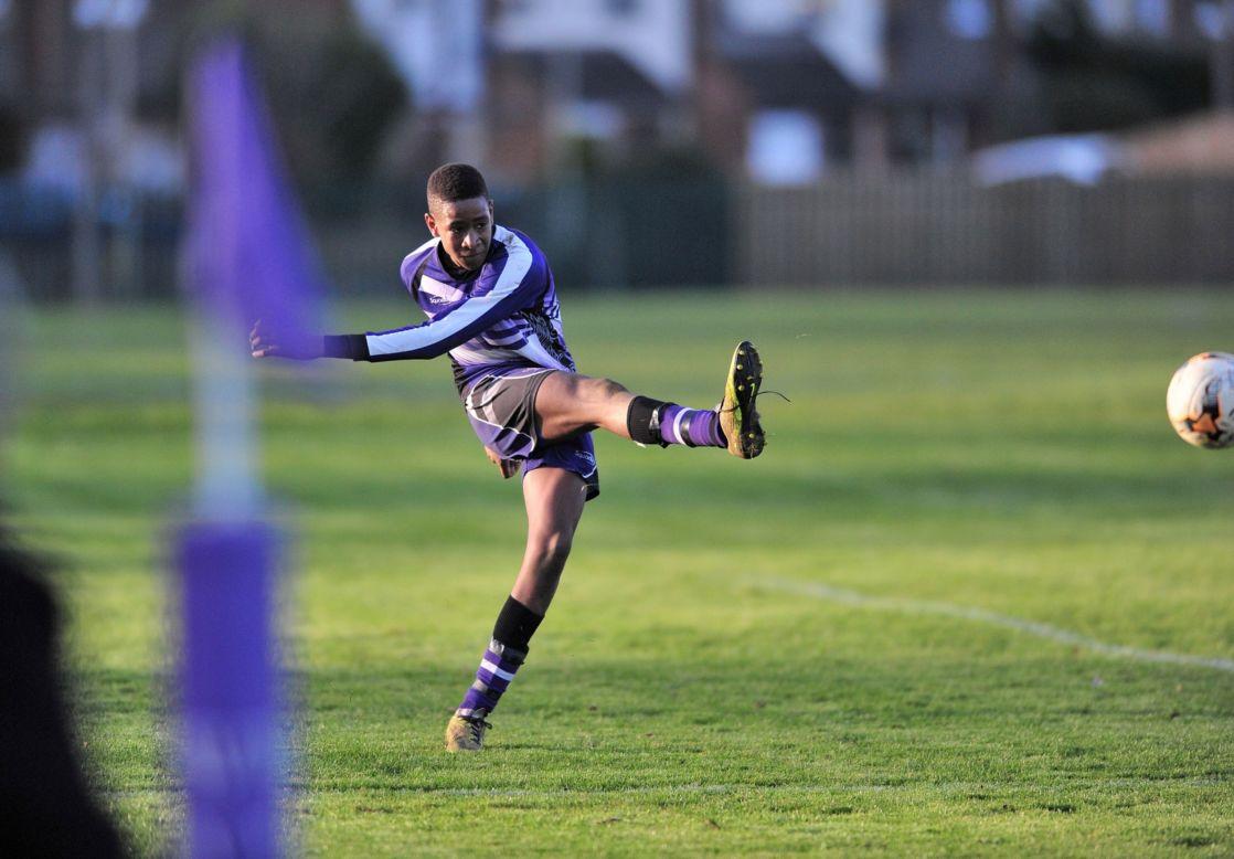 wycliffe senior student kicking a ball