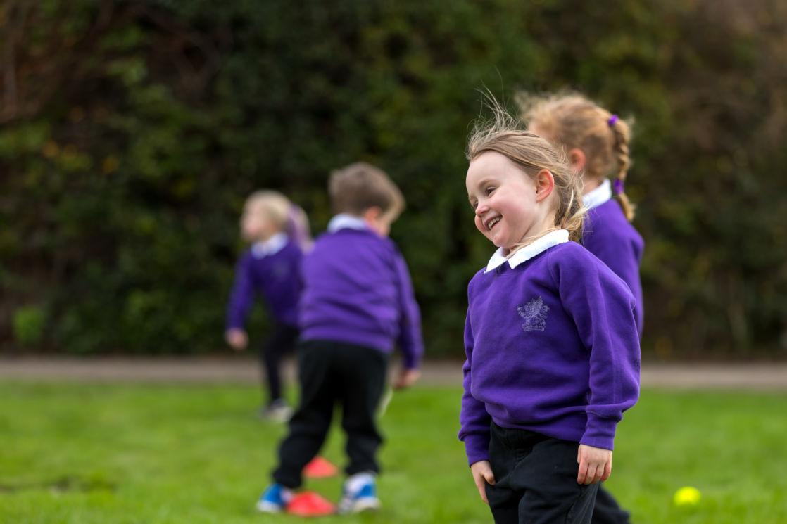 wycliffe nursery pupils walking through the garden