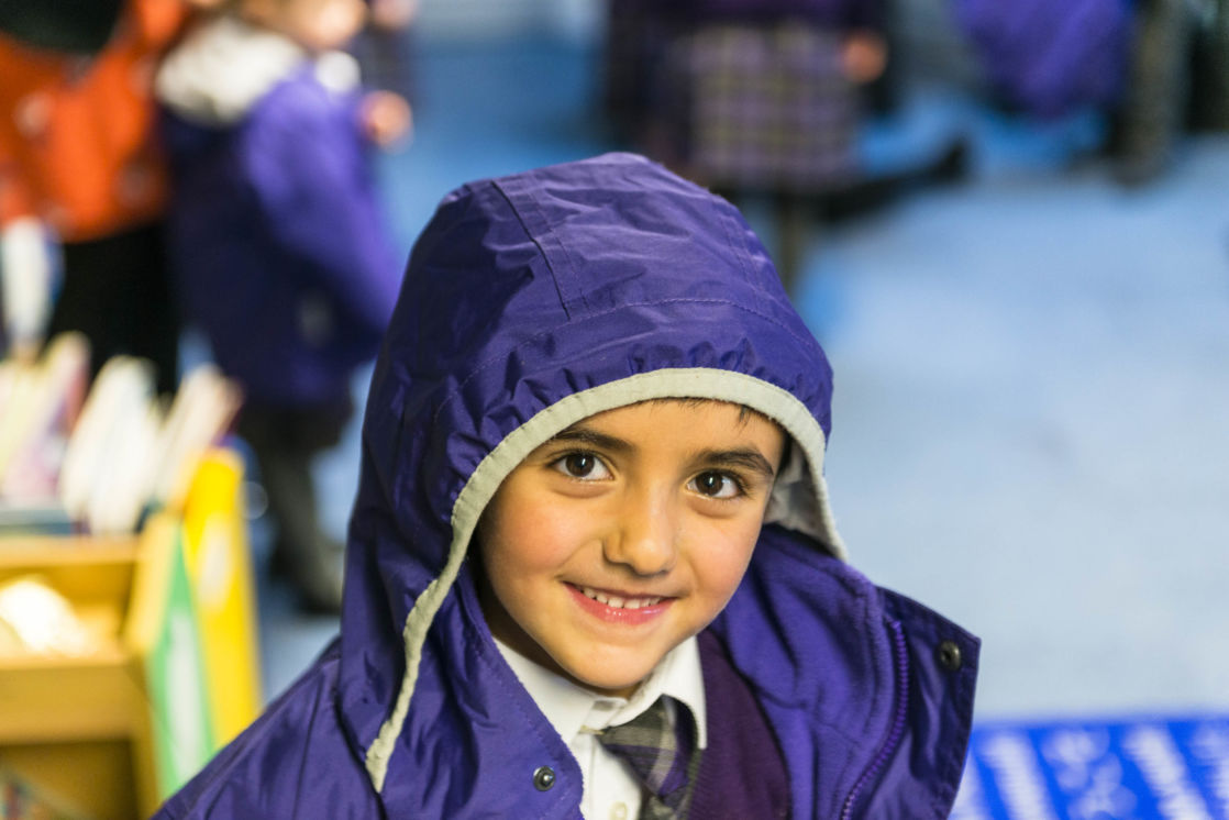 wycliffe pre prep student smiling wearing a trenchcoat