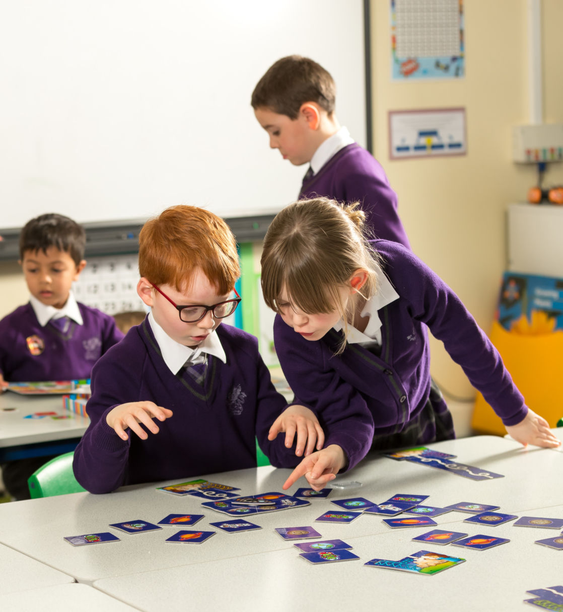 wycliffe pupils playing with cards in class