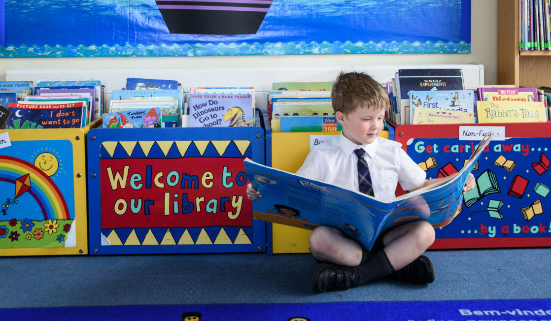 wycliffe nursery pupil reading a book