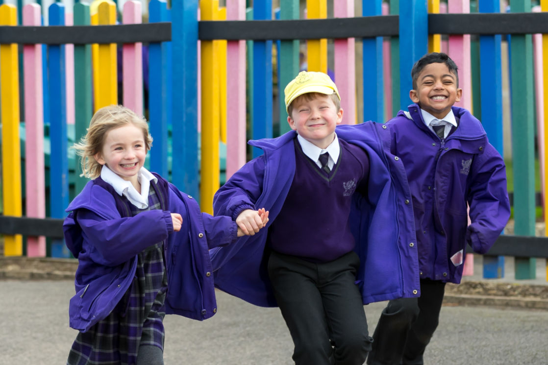 wycliffe kids running outside with coats
