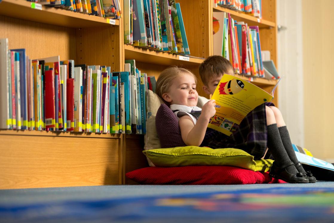wycliffe nursery chikdren reading in the library