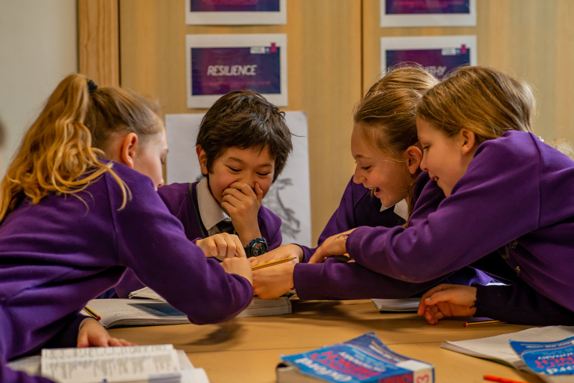 group of wycliffe students laughing in class